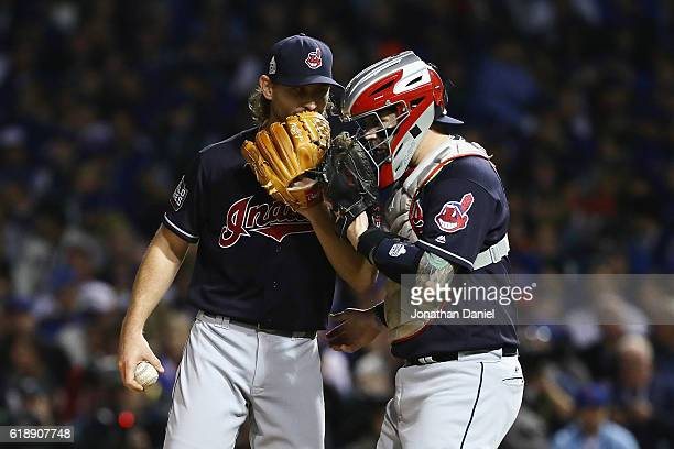 Josh Tomlin of the Cleveland Indians talks with Roberto Perez in the second inning against the Chicago Cubs in Game Three of the 2016 World Series at...