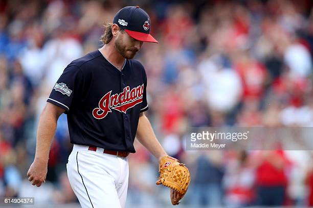 Josh Tomlin of the Cleveland Indians walks back to the dugout after closing out the third inning by striking out Jose Bautista of the Toronto Blue...