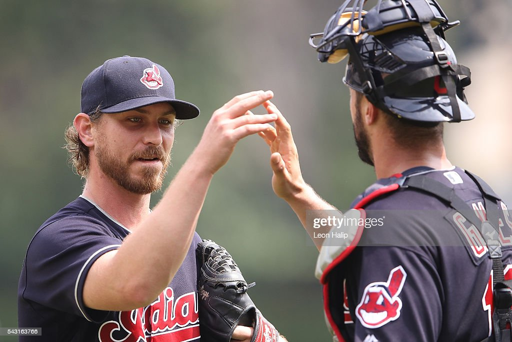 <a gi-track='captionPersonalityLinkClicked' href=/galleries/search?phrase=Josh+Tomlin&family=editorial&specificpeople=7130975 ng-click='$event.stopPropagation()'>Josh Tomlin</a> #43 of the Cleveland Indians walks off the mound and celebrates with catcher <a gi-track='captionPersonalityLinkClicked' href=/galleries/search?phrase=Yan+Gomes&family=editorial&specificpeople=9004037 ng-click='$event.stopPropagation()'>Yan Gomes</a> #10 at the end of the eight inning during the game against the Detroit Tigers on June 26, 2016 at Comerica Park in Detroit, Michigan.