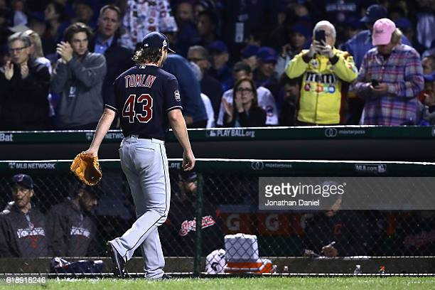 Josh Tomlin of the Cleveland Indians walks to the dugout after being relieved in the fifth inning against the Chicago Cubs in Game Three of the 2016...