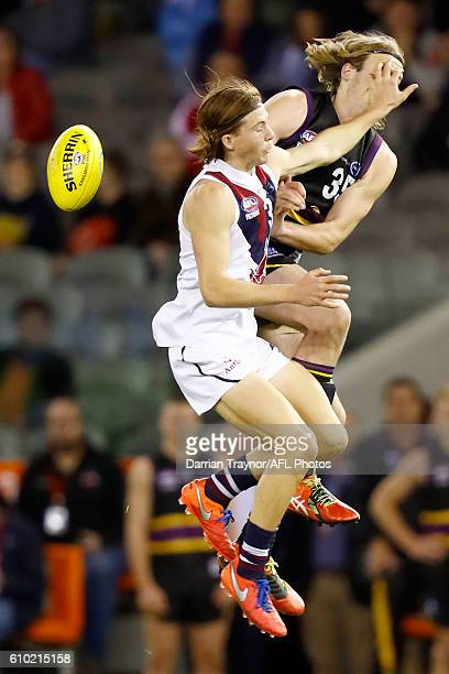 Josh Trew of the Dragons and Max Lynch of the Bushrangers compete during the TAC Cup Grand Final match between the Murray Bushrangers and the...