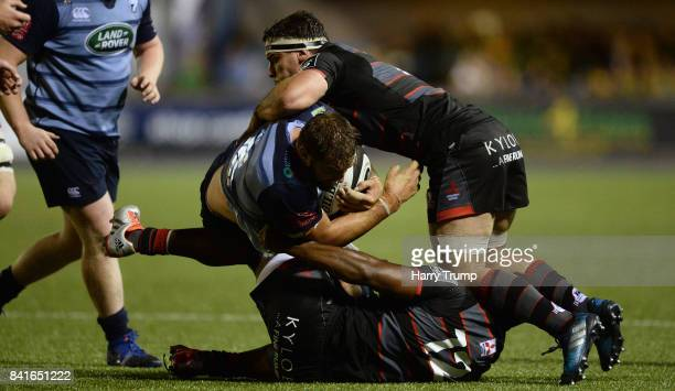 Josh Turnbull of Cardiff Blues is tackled by Junior Rasolea of Edinburgh during the Guinness Pro14 match between Cardiff Blues and Edinburgh at...