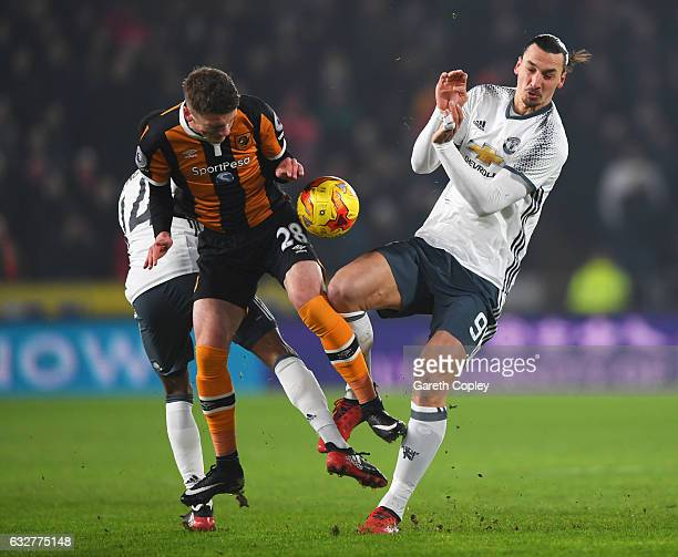 Josh Tymon of Hull City battles for the ball with Jesse Lingard and Zlatan Ibrahimovic of Manchester United during the EFL Cup SemiFinal second leg...