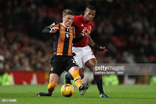 Josh Tymon of Hull City competes with Antonio Valencia of Manchester United during the EFL Cup SemiFinal first leg match between Manchester United...