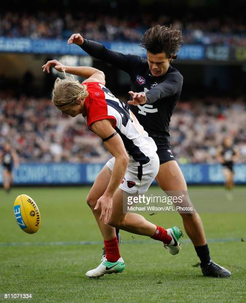 Josh Wagner of the Demons and Jack Silvagni of the Blues compete for the ball during the 2017 AFL round 16 match between the Carlton Blues and the...
