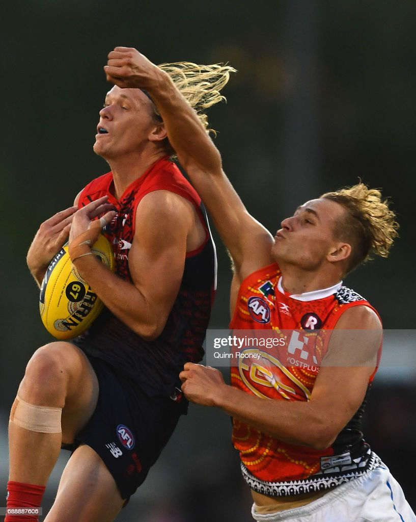 Josh Wagner of the Demons marks infront of Will Brodie of the Suns during the round ten AFL match between the Melbourne Demons and the Gold Coast Suns at Traeger Park on May 27, 2017 in Alice Springs, Australia.