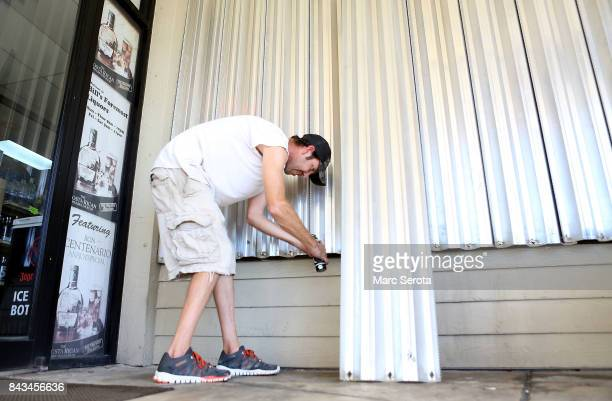 Josh Walker installs hurricane shutters at Dillon's Pub in Islamorada Florida on September 6 2017T he storm has grown to a category 5 and is expected...
