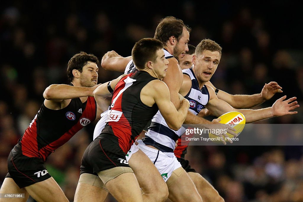 Josh Walker of the Cats breaks a tackle during the round 10 AFL match between the Essendon Bombers and the Geelong Cats at Etihad Stadium on June 6...