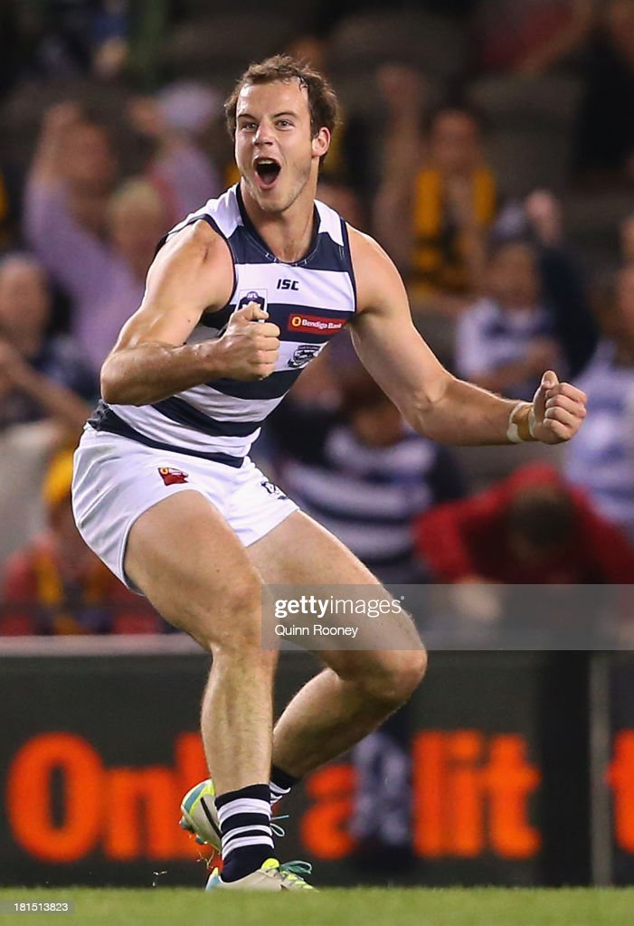 <a gi-track='captionPersonalityLinkClicked' href=/galleries/search?phrase=Josh+Walker&family=editorial&specificpeople=808667 ng-click='$event.stopPropagation()'>Josh Walker</a> of the Cats celebrates kicking a goal during the VFL Grand Final match between the Box Hill Hawks and the Geelong Cats at Etihad Stadium on September 22, 2013 in Melbourne, Australia.