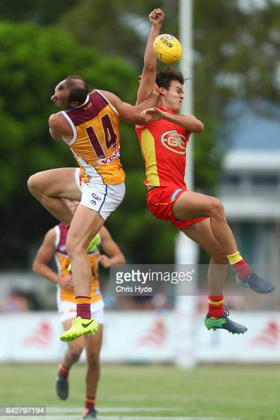Josh Walker of the Lions and Jack Bowes of the Suns compete for the ball during the 2017 JLT Community Series match at Broadbeach Sports Centre on...