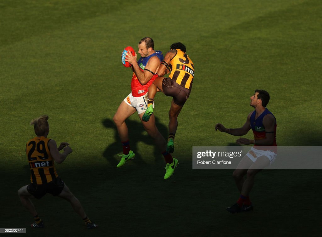 Josh Walker of the Lions is challenged by Cyril Rioli of the Hawks during the round eight AFL match between the Hawthorn Hawks and the Brisbane Lions at University of Tasmania Stadium on May 13, 2017 in Launceston, Australia.