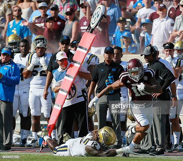 Josh Walker of the Texas AM Aggies breaks the tackle attempt by Jayon Brown of the UCLA Bruins on September 3 2016 in College Station Texas