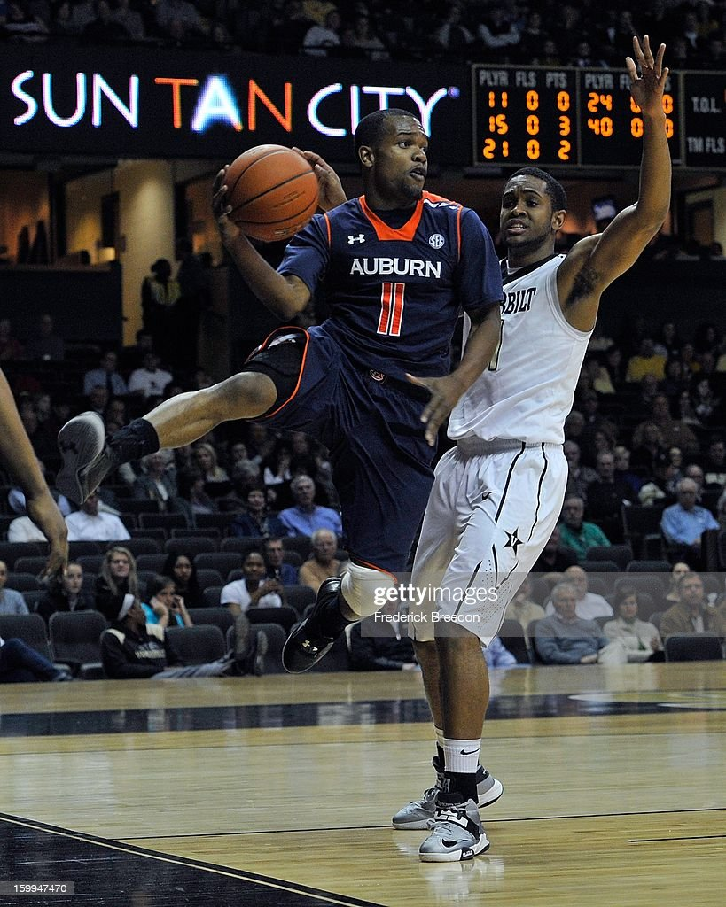 Josh Wallace #11 of the Auburn Tigers looks to pass from the baseline against the Vanderbilt Commodores at Memorial Gym on January 23, 2013 in Nashville, Tennessee.