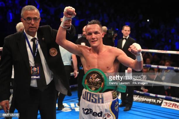 Josh Warrington celebrates beating Kiko Martinez during their WBC International Featherweight Championship bout at the First Direct Arena Leeds