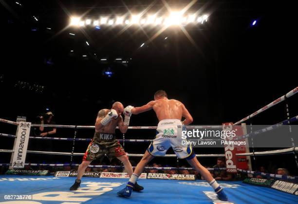 Josh Warrington in action against Kiko Martinez during their WBC International Featherweight Championship bout at the First Direct Arena Leeds