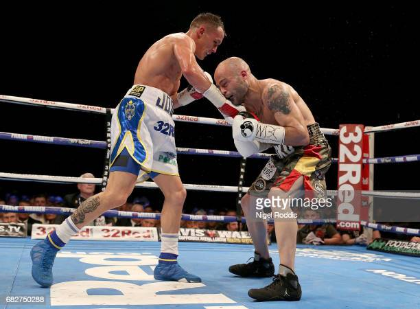 Josh Warrington in action against Kiko Martinez during their WBC International Featherweight Championship fight at First Direct Arena Leeds on May 13...