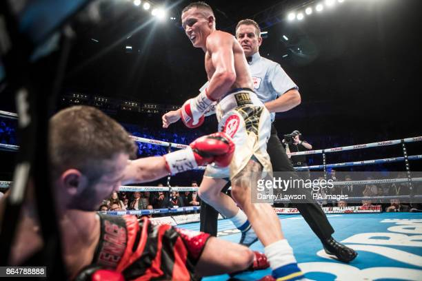 Josh Warrington knocks down Dennis Ceylan during their Featherweight bout at the First Direct Arena Leeds