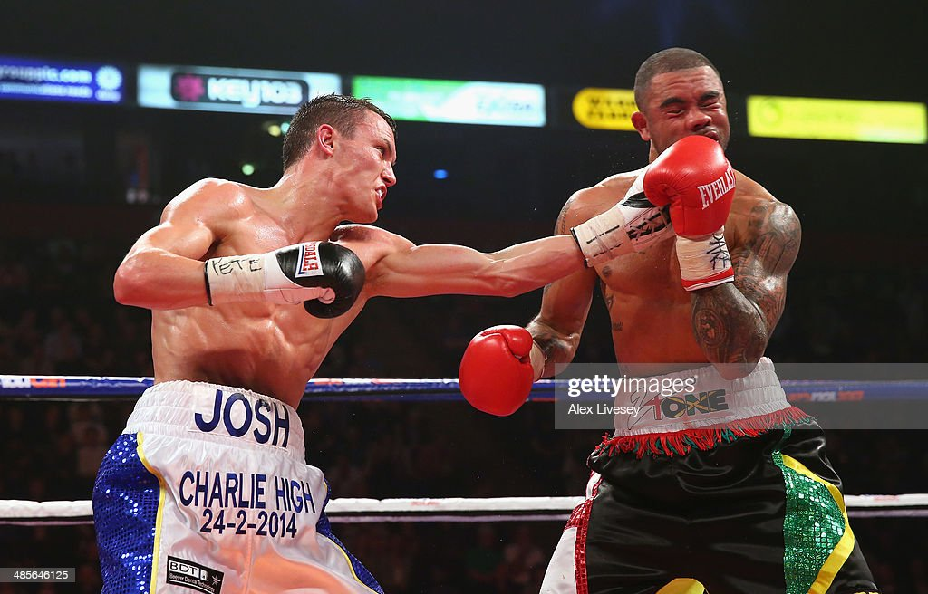 Josh Warrington lands a left hand on Rendall Munroe during the Commonwealth Featherweight Title fight between Josh Warrington and Rendall Munroe at...