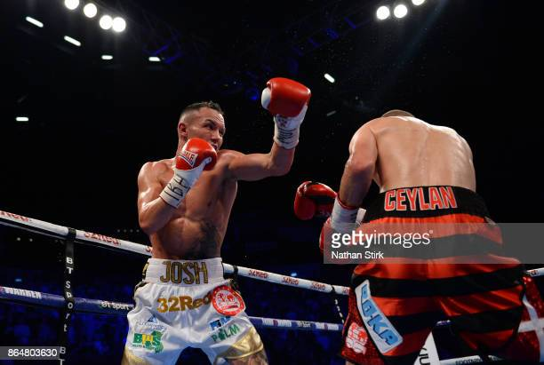 Josh Warrington lands a shot on Dennis Ceylan during the IBF Featherweight World title fight at First Direct Arena Leeds on October 21 2017 in Leeds...