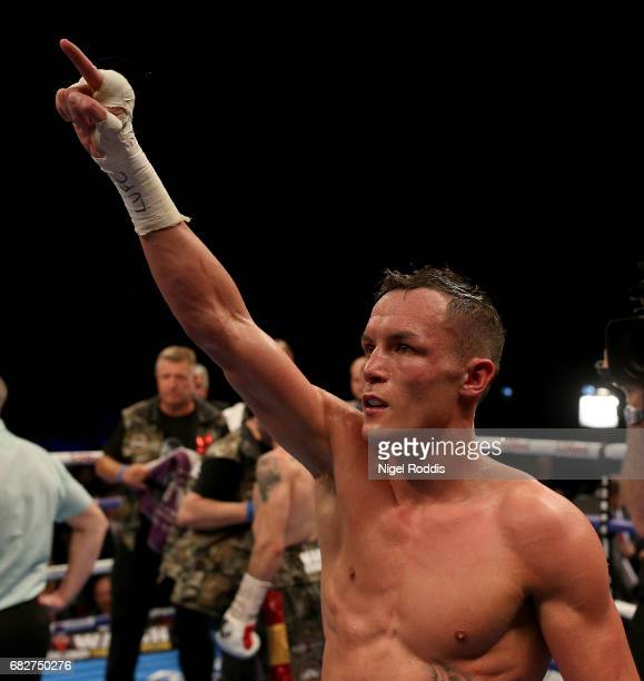 Josh Warrington reacts after beating Kiko Martinez during their WBC International Featherweight Championship fight at First Direct Arena Leeds on May...