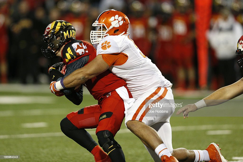 Josh Watson #91 of the Clemson Tigers sacks Caleb Rowe #7 of the Maryland Terrapins during the game at Byrd Stadium on October 26, 2013 in College Park, Maryland. Clemson won 40-27.