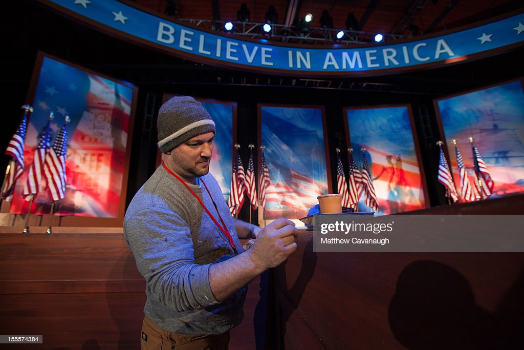Josh Weil, of Mystic Scenic Studios, paints the stage where U.S. Republican presidential candidate, former Massachusetts Governor Mitt Romney will speak at an election night event, on November 5, 2012 in Boston, Massachusetts. National polls show that Romney and U.S. President Barack Obama are in a virtual dead heat in the race for the presidential election on Tuesday.