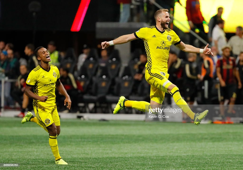 Josh Williams #3 and Ola Kamara #11 of the Columbus Crew celebrates after Adam Jahn #12 converts a penalty kick to give the Crew a win over the Atlanta United 3-1 on penalties during the Eastern Conference knockout round at Mercedes-Benz Stadium on October 26, 2017 in Atlanta, Georgia.