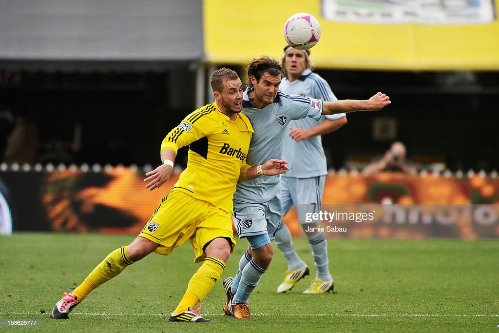 Josh Williams #3 of the Columbus Crew and Graham Zusi #8 of Sporting Kansas City battle for position on a loose ball in the first half on October 7, 2012 at Crew Stadium in Columbus, Ohio.