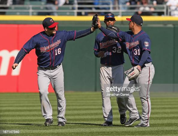 Josh Willingham Aaron Hicks and Oswaldo Arcia of the Minnesota Twins celebrate a win over the Chicago White Sox at US Cellular Field on April 21 2013...