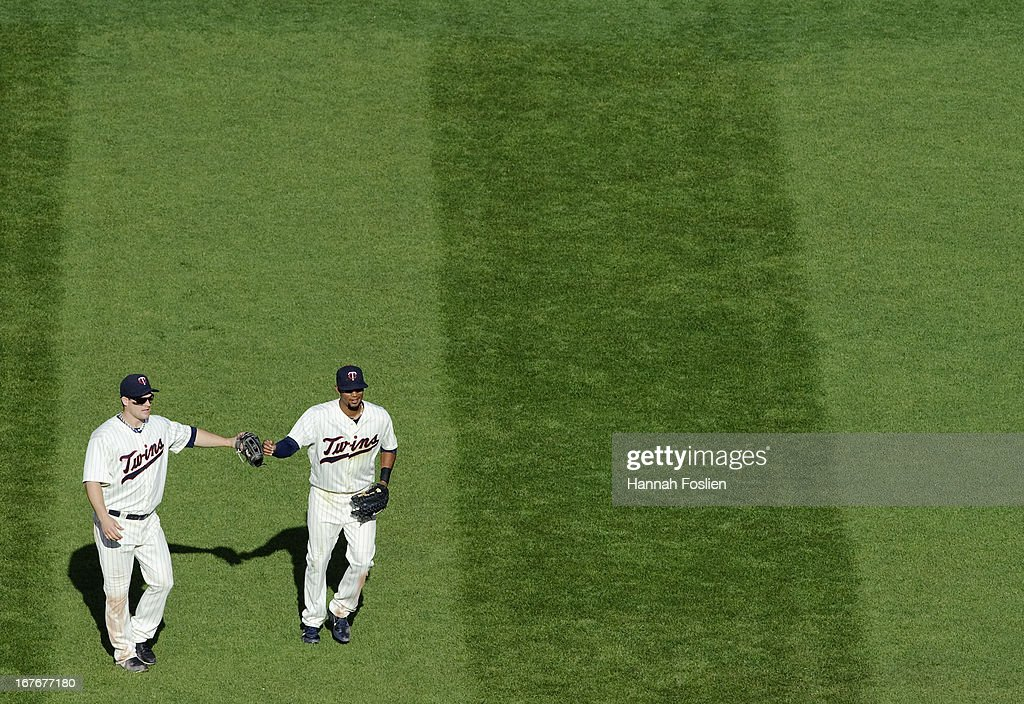 Josh Willingham #16 and Aaron Hicks #32 of the Minnesota Twins celebrates a win of the game against the Texas Rangers on April 27, 2013 at Target Field in Minneapolis, Minnesota. The Twins defeated the Rangers 7-2.