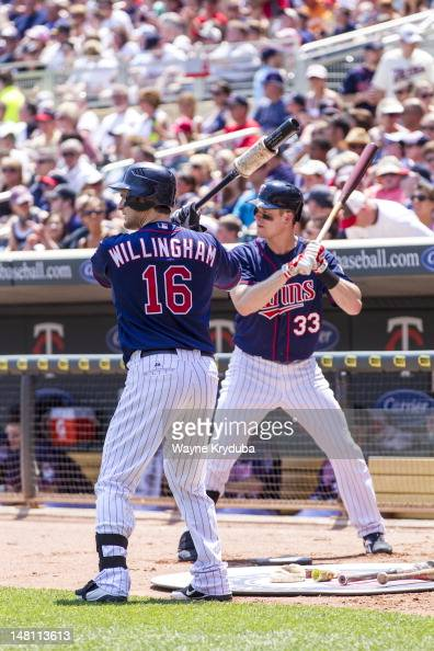 Josh Willingham and Justin Morneau of the Minnesota Twins warm up before batting against the Kansas City Royals on July 1 2012 at Target Field in...