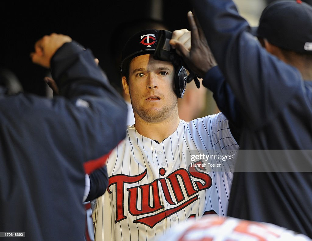 Josh Willingham #16 of the Minnesota Twins celebrates scoring a run against the Philadelphia Phillies during the fourth inning of the game on June 11, 2013 at Target Field in Minneapolis, Minnesota.
