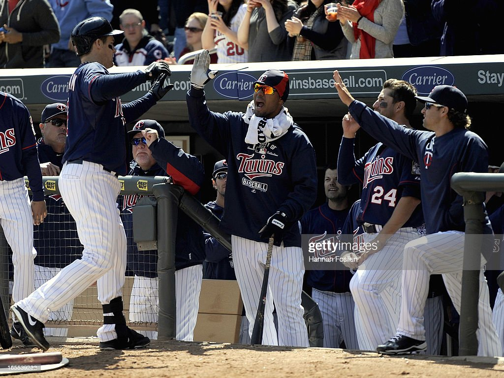 <a gi-track='captionPersonalityLinkClicked' href=/galleries/search?phrase=Josh+Willingham&family=editorial&specificpeople=537640 ng-click='$event.stopPropagation()'>Josh Willingham</a> #16 of the Minnesota Twins celebrates with his teammates after hitting a two run home run against the Detroit Tigers during the third inning of the game on April 4, 2013 at Target Field in Minneapolis, Minnesota.