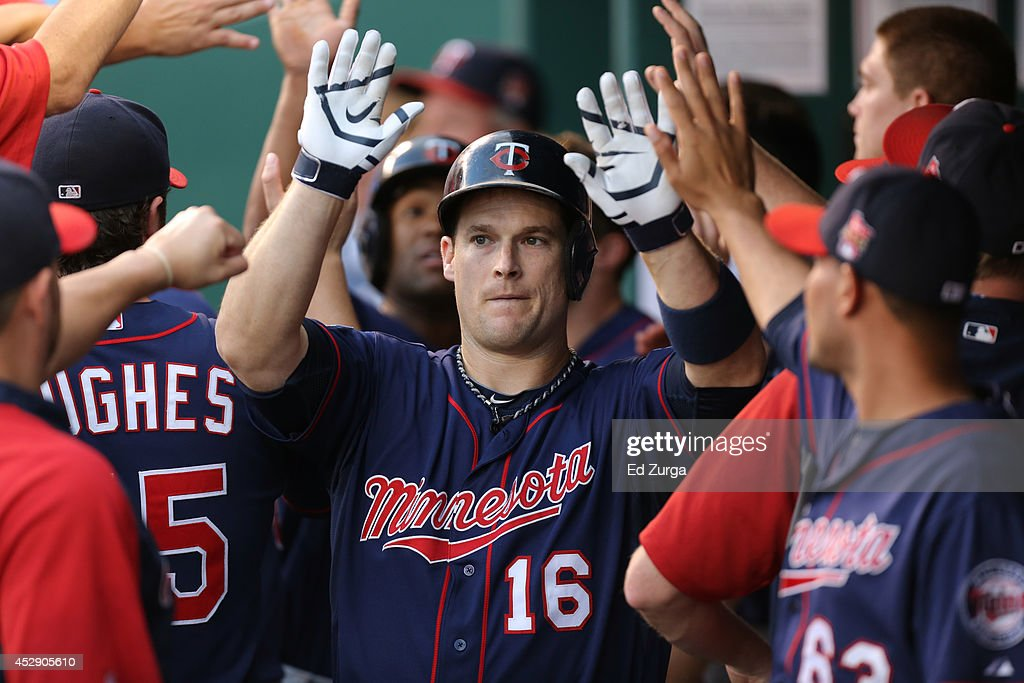 <a gi-track='captionPersonalityLinkClicked' href=/galleries/search?phrase=Josh+Willingham&family=editorial&specificpeople=537640 ng-click='$event.stopPropagation()'>Josh Willingham</a> #16 of the Minnesota Twins celebrates with teammates after hitting a sacrifice fly in the third inning against the Kansas City Royals at Kauffman Stadium on July 29, 2014 in Kansas City, Missouri.