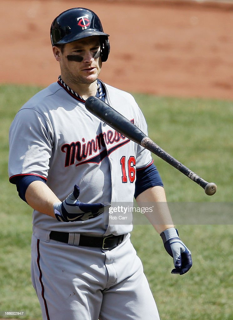 <a gi-track='captionPersonalityLinkClicked' href=/galleries/search?phrase=Josh+Willingham&family=editorial&specificpeople=537640 ng-click='$event.stopPropagation()'>Josh Willingham</a> #16 of the Minnesota Twins flips his bat in the air after being hit by a pitch against the Baltimore Orioles at Oriole Park at Camden Yards on April 7, 2013 in Baltimore, Maryland.