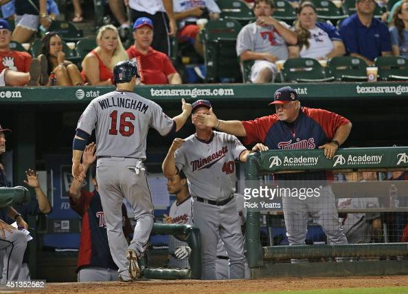 Josh Willingham of the Minnesota Twins is congratulated after scoring on a single RBI hit by Oswaldo Arcia at Globe Life Park in Arlington on June 27...