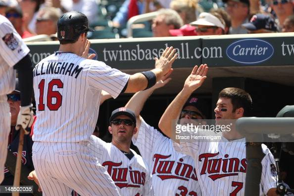 Josh Willingham of the Minnesota Twins is congratulated by Joe Mauer Justin Morneau and Drew Butera against the Kansas City Royals on June 30 2012 at...
