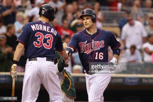 Josh Willingham of the Minnesota Twins is congratulated by Justin Morneau after hitting a home run against the Oakland Athletics on July 13 2012 at...