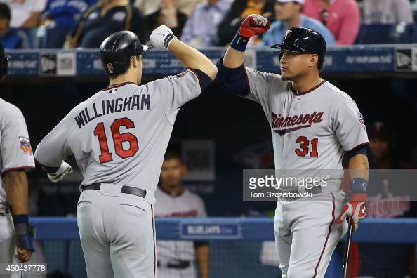 Josh Willingham of the Minnesota Twins is congratulated by Oswaldo Arcia after hitting a tworun home run in the first inning during MLB game action...
