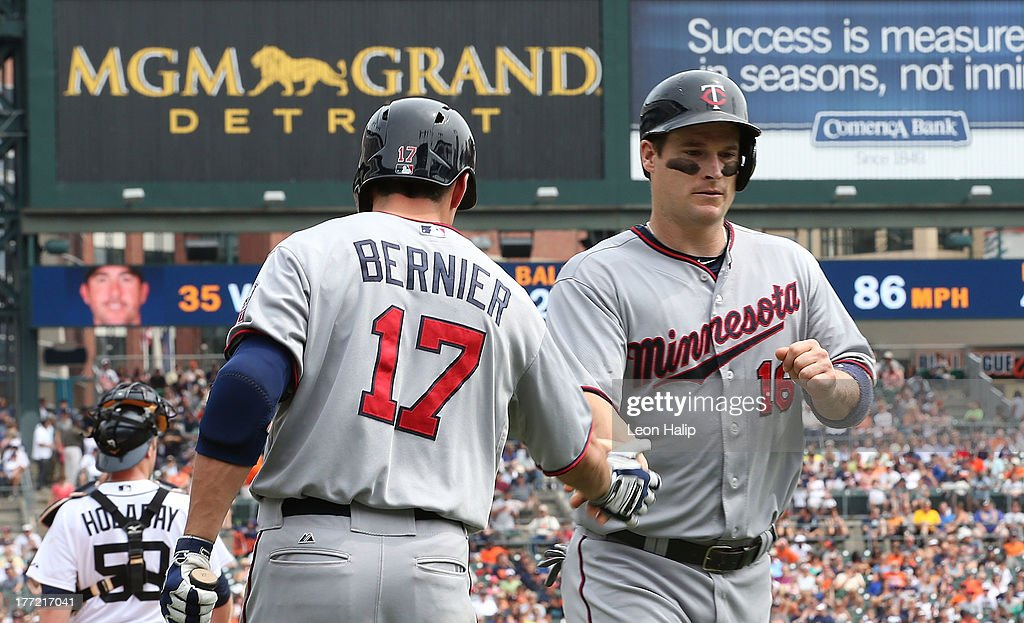 <a gi-track='captionPersonalityLinkClicked' href=/galleries/search?phrase=Josh+Willingham&family=editorial&specificpeople=537640 ng-click='$event.stopPropagation()'>Josh Willingham</a> #16 of the Minnesota Twins is congratulated by teammate Doug Bernier #17 after scoring on the single by <a gi-track='captionPersonalityLinkClicked' href=/galleries/search?phrase=Wilkin+Ramirez&family=editorial&specificpeople=4959083 ng-click='$event.stopPropagation()'>Wilkin Ramirez</a> #22 in the fourth inning of the game against the Detroit Tigers at Comerica Park on August 22, 2013 in Detroit, Michigan. The Twins defeated the Tigers 7-6.