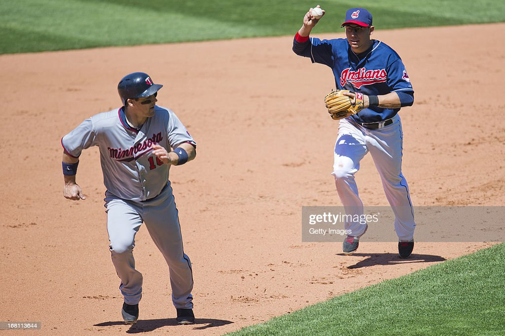 <a gi-track='captionPersonalityLinkClicked' href=/galleries/search?phrase=Josh+Willingham&family=editorial&specificpeople=537640 ng-click='$event.stopPropagation()'>Josh Willingham</a> #16 of the Minnesota Twins is fought in a rundown by shortstop Asdrubal Cabrera #13 of the Cleveland Indians during the sixth inning at Progressive Field on May 5, 2013 in Cleveland, Ohio. The Twins defeated the Indians 4-2.