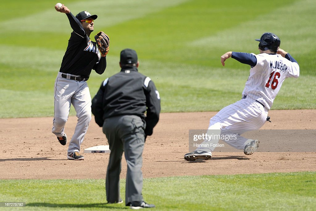 Josh Willingham #16 of the Minnesota Twins is out at second base as Donovan Solano #17 of the Miami Marlins turns a double play and umpire D.J. Reyburn #70 looks on during the third inning of the first game of a doubleheader on April 23, 2013 at Target Field in Minneapolis, Minnesota.