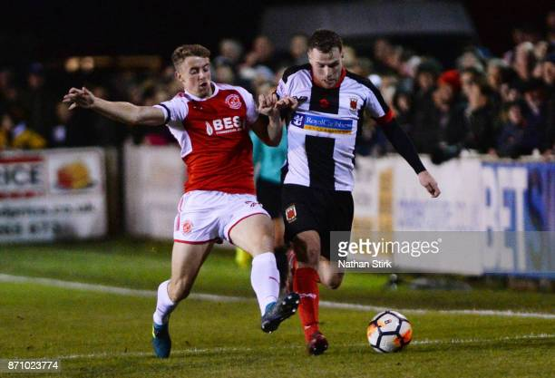 Josh Wilson of Chorley and Jack Sowerby of Fleetwood Town in action during The Emirates FA Cup First Round match between Chorley and Fleetwood Town...