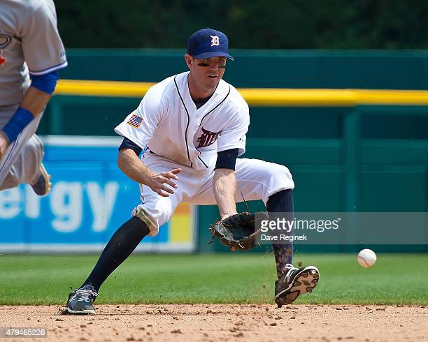 Josh Wilson of the Detroit Tigers fields the ball at shortstop during a MLB game against the Toronto Blue Jays at Comerica Park on July 4 2015 in...