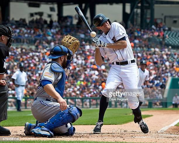 Josh Wilson of the Detroit Tigers is hit in the hands by a pitch during a MLB game against the Toronto Blue Jays at Comerica Park on July 4 2015 in...