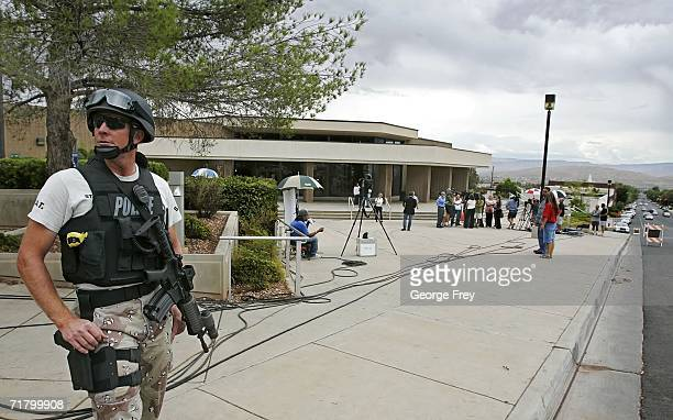 Josh Wilson of the St George Police Department stands guard outside the 5th Judicial District Courthouse during the first court hearing for...