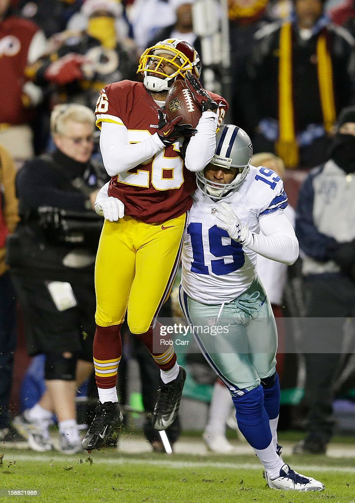 Josh Wilson #26 of the Washington Redskins intercepts a pass intended for <a gi-track='captionPersonalityLinkClicked' href=/galleries/search?phrase=Miles+Austin&family=editorial&specificpeople=756585 ng-click='$event.stopPropagation()'>Miles Austin</a> #19 of the Dallas Cowboys in the first quarter at FedExField on December 30, 2012 in Landover, Maryland.
