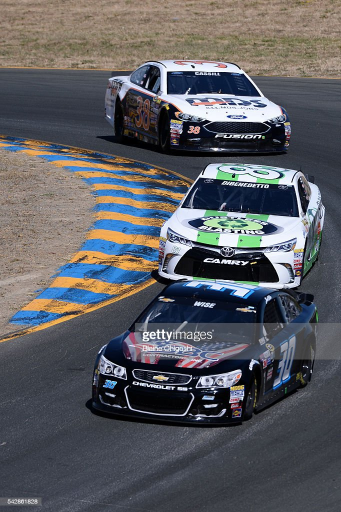 Josh Wise, driver of the #30 Curtis Key Plumbing Chevrolet, and Matt DiBenedetto, driver of the #83 Dustless Blasting Toyota, drive during practice for the NASCAR Sprint Cup Series Toyota/Save Mart 350 at Sonoma Raceway on June 24, 2016 in Sonoma, California.