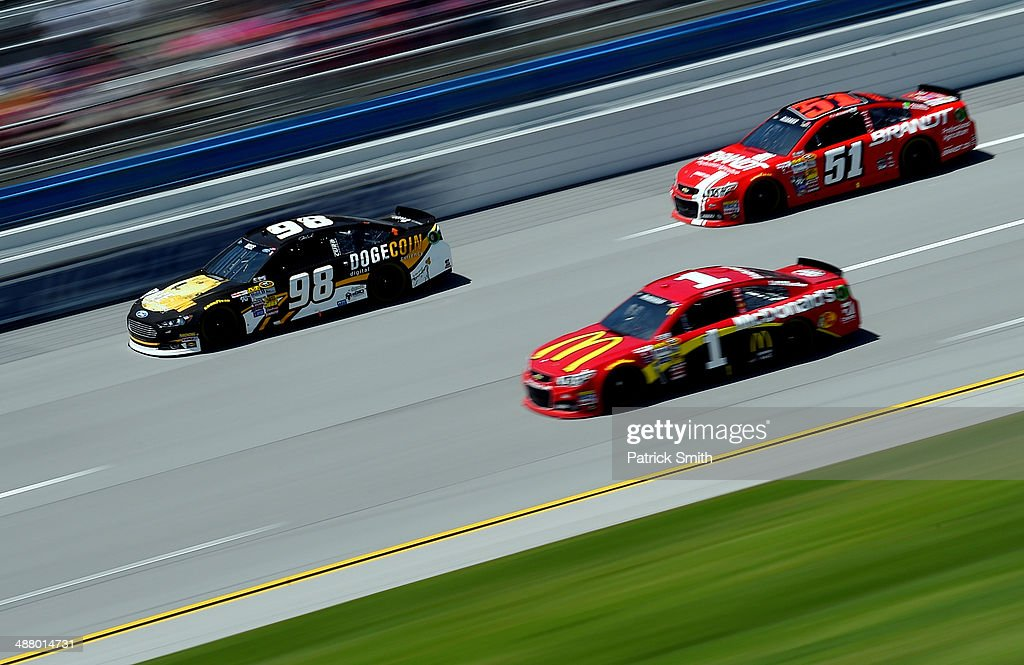 <a gi-track='captionPersonalityLinkClicked' href=/galleries/search?phrase=Josh+Wise+-+Race+Car+Driver&family=editorial&specificpeople=12854682 ng-click='$event.stopPropagation()'>Josh Wise</a>, driver of the #98 Dogecoin / Reddit.com Ford, leads a pack of cars during qualifying for the NASCAR Sprint Cup Series Aaron's 499 at Talladega Superspeedway on May 3, 2014 in Talladega, Alabama.