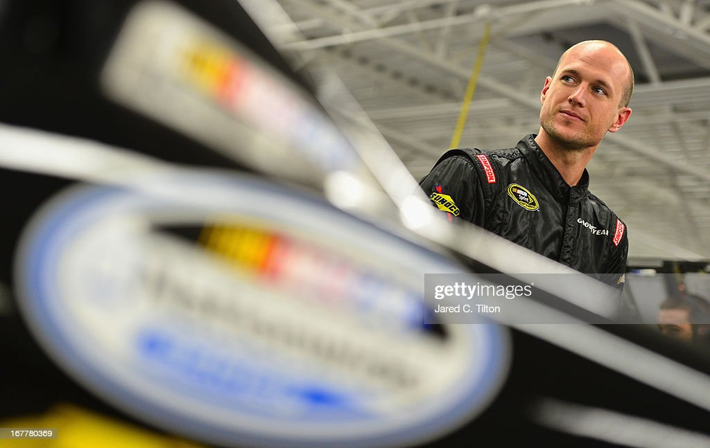 Josh Wise, driver of the #35 MDS Transport Ford, waits in the garage during practice for the NASCAR Nationwide Series at Las Vegas Motor Speedway on March 8, 2013 in Las Vegas, Nevada.
